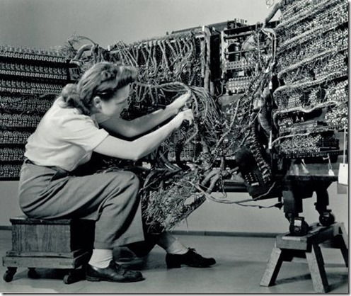 woman wiring an early ibm computer
